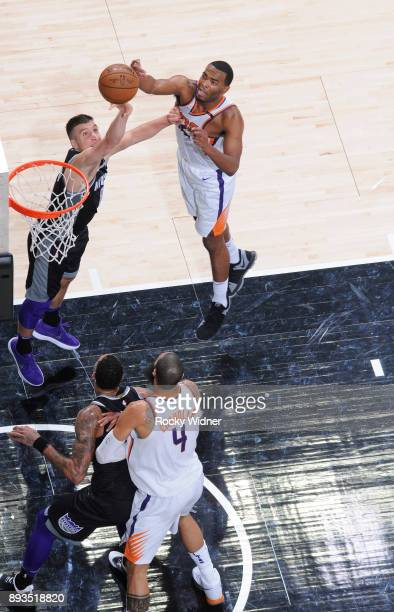 Bogdan Bogdanovic of the Sacramento Kings rebounds against TJ Warren of the Phoenix Suns on December 12 2017 at Golden 1 Center in Sacramento...