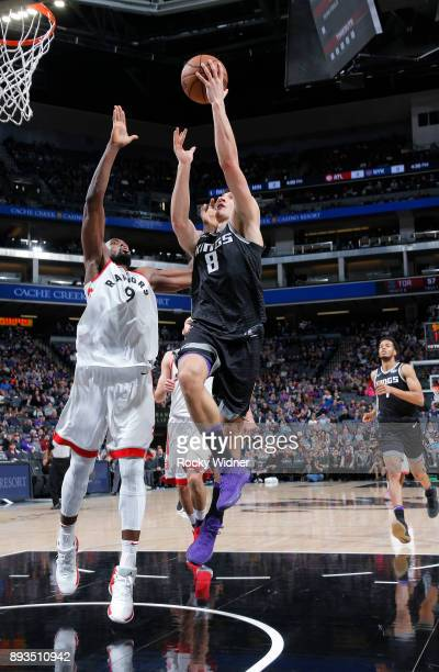 Bogdan Bogdanovic of the Sacramento Kings shoots a layup against Serge Ibaka of the Toronto Raptors on December 10 2017 at Golden 1 Center in...