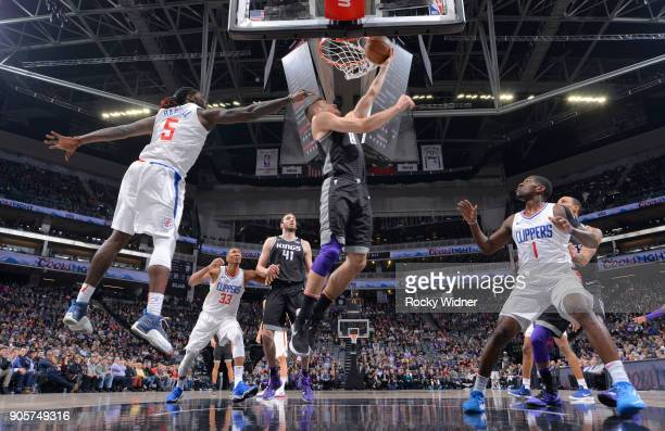 Bogdan Bogdanovic of the Sacramento Kings shoots a layup against Montrezl Harrell of the Los Angeles Clippers on January 11 2018 at Golden 1 Center...