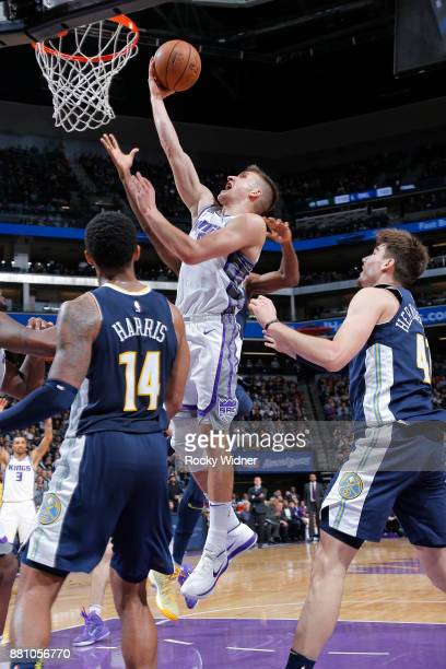 Bogdan Bogdanovic of the Sacramento Kings shoots a layup against the Denver Nuggets on November 20 2017 at Golden 1 Center in Sacramento California...