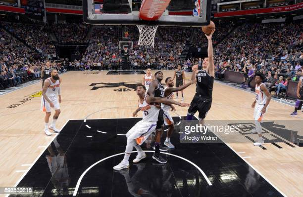 Bogdan Bogdanovic of the Sacramento Kings shoots a layup against the Phoenix Suns on December 12 2017 at Golden 1 Center in Sacramento California...