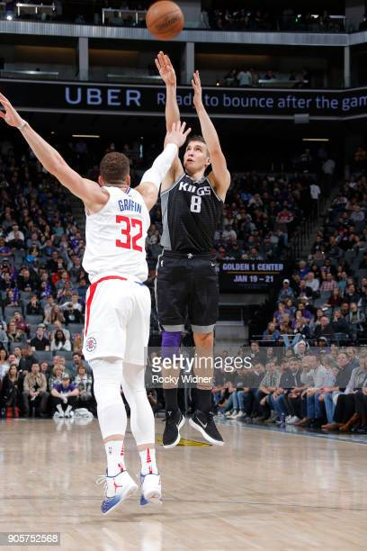 Bogdan Bogdanovic of the Sacramento Kings shoots a three pointer against Blake Griffin of the Los Angeles Clippers on January 11 2018 at Golden 1...