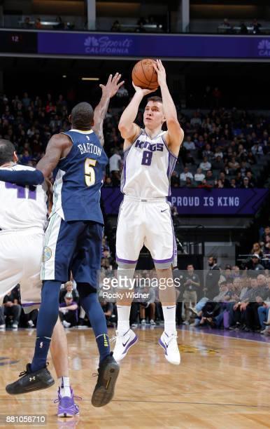 Bogdan Bogdanovic of the Sacramento Kings shoots a three pointer against the Denver Nuggets on November 20 2017 at Golden 1 Center in Sacramento...