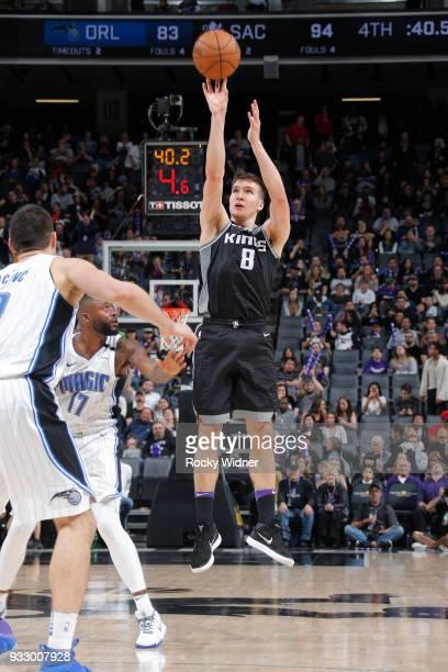 Bogdan Bogdanovic of the Sacramento Kings shoots a three pointer against the Orlando Magic on March 9 2018 at Golden 1 Center in Sacramento...