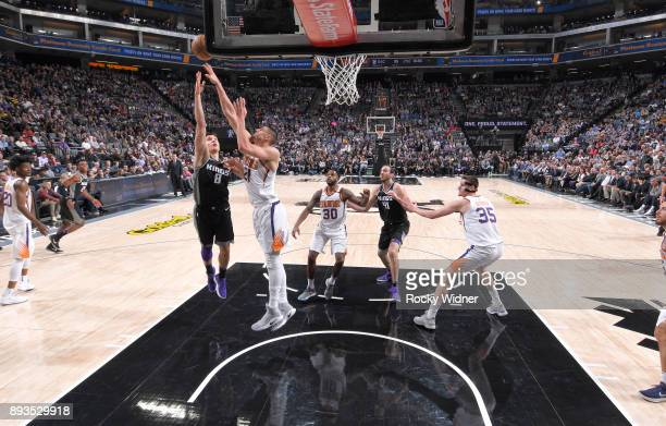 Bogdan Bogdanovic of the Sacramento Kings shoots against Alex Len of the Phoenix Suns on December 12 2017 at Golden 1 Center in Sacramento California...