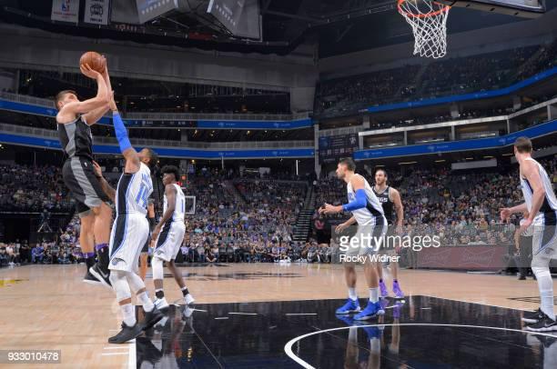 Bogdan Bogdanovic of the Sacramento Kings shoots against DJ Augustin of the Orlando Magic on March 9 2018 at Golden 1 Center in Sacramento California...