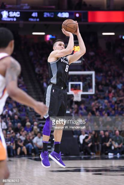 Bogdan Bogdanovic of the Sacramento Kings shoots against the Phoenix Suns during an NBA basketball game at Golden 1 Center on December 12 2017 in...