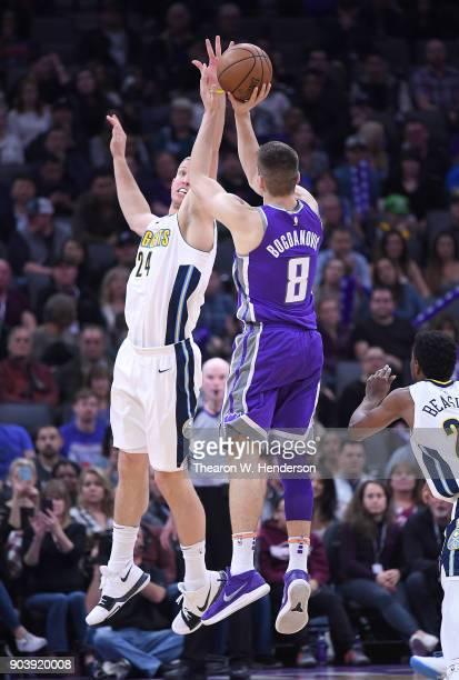 Bogdan Bogdanovic of the Sacramento Kings shoots over Mason Plumlee of the Denver Nuggets during an NBA Basketball game at Golden 1 Center on January...