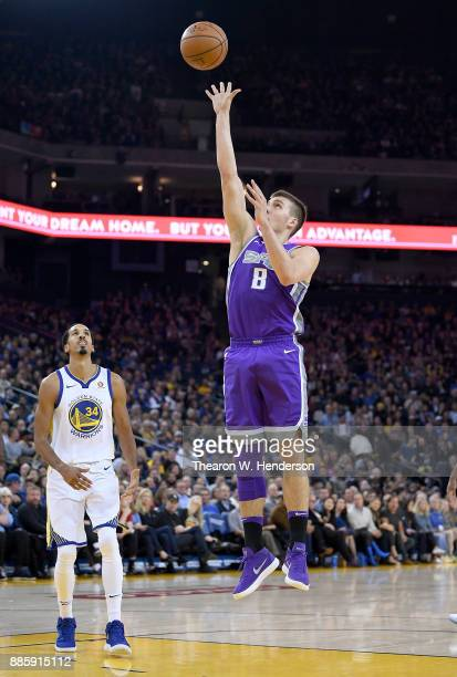 Bogdan Bogdanovic of the Sacramento Kings shoots the ball against the Golden State Warriors during their NBA basketball game at ORACLE Arena on...