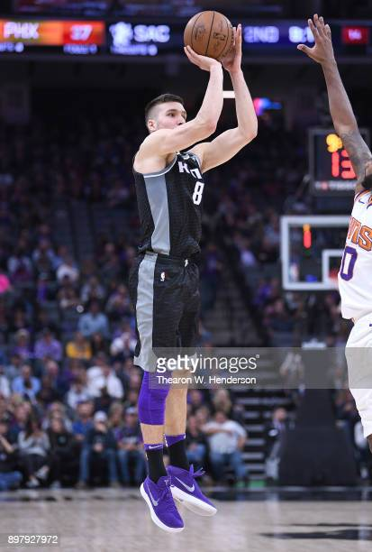 Bogdan Bogdanovic of the Sacramento Kings shoots the ball against the Phoenix Suns during an NBA basketball game at Golden 1 Center on December 12...