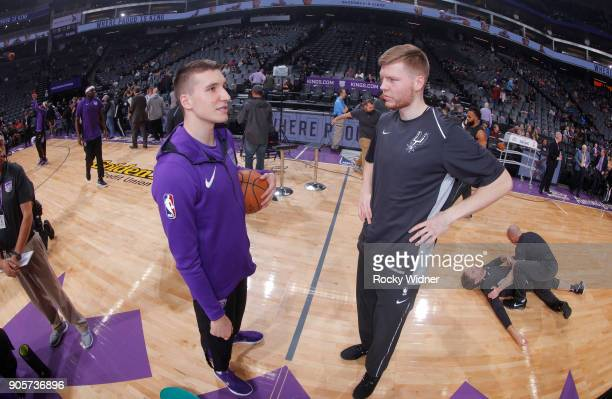 Bogdan Bogdanovic of the Sacramento Kings talks with Davis Bertans of the San Antonio Spurs prior to the game on January 8 2018 at Golden 1 Center in...