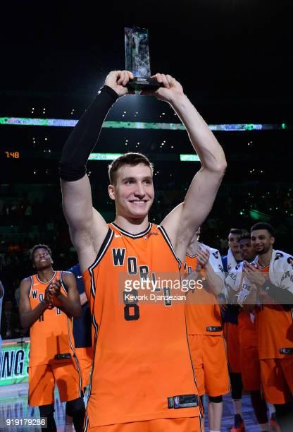 Bogdan Bogdanovic of the World Team raises the 'Rising Stars Challenge MVP Trophy' during the 2018 Mountain Dew Kickstart Rising Stars Game at...