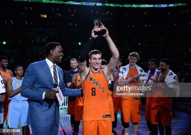Bogdan Bogdanovic of the World Team raises the 'Rising Stars Challenge MVP Trophy' with Chris Webber during the 2018 Mountain Dew Kickstart Rising...