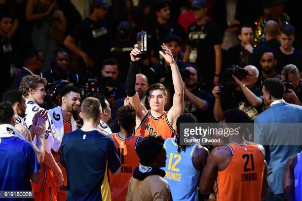 Bogdan Bogdanovic of the World team receives the Mountain Dew Kickstart Rising Stars Game MVP trophy after the game against the USA Team during...