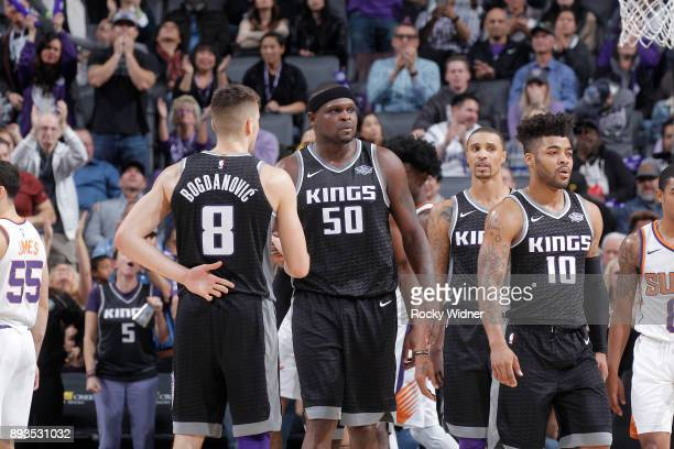 Bogdan Bogdanovic Zach Randolph George Hill and Frank Mason III of the Sacramento Kings face the Phoenix Suns on December 12 2017 at Golden 1 Center...