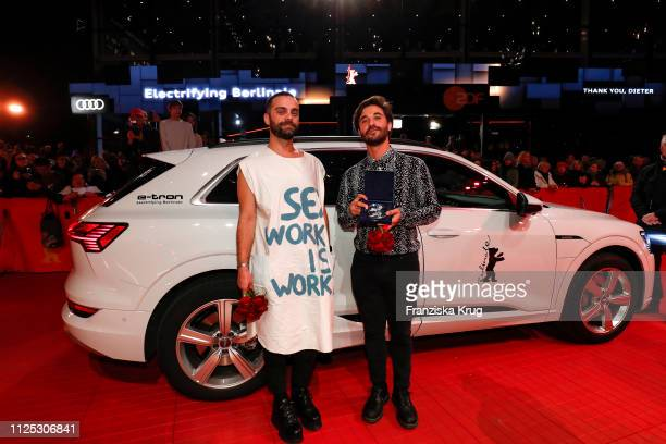 Bogdan Georgescu and Manuel Abramovich pose in front of Audi etron car for the closing ceremony of the 69th Berlinale International Film Festival...