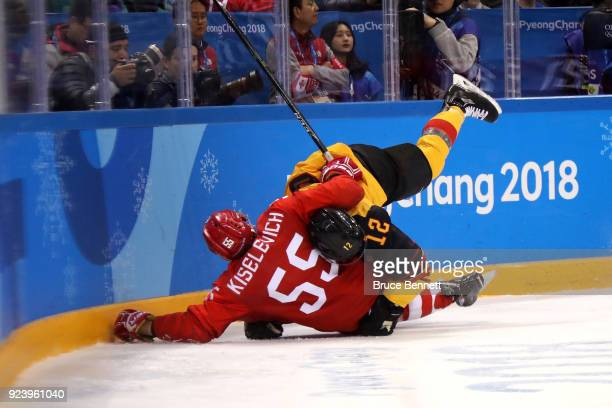 Bogdan Kiselevich of Olympic Athlete from Russia and Brooks Macek of Germany collide in the third period during the Men's Gold Medal Game on day...