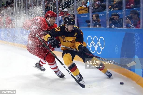 Bogdan Kiselevich of Olympic Athlete from Russia competes for the puck against Patrick Hager of Germany in the first period during the Men's Gold...