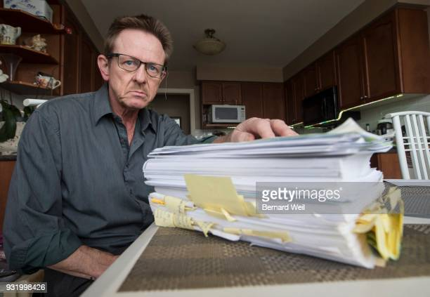 OSHAWA ON FEBRUARY 28 Bogdan Koscik sits near a stack of paperwork he has collected over the years after getting fired following a workplace injury...