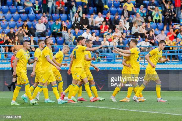 Bogdan Lednev of Ukraine celebrates after scoring his team's first goal with teammates during the international friendly match between Ukraine and...