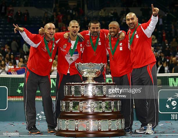 Bogdan Obradovic, Nenad Zimonjic, Novak Djokovic, Janko Tipsarevic and Viktor Troicki of Serbia celebrate with the trophy after defeating France...