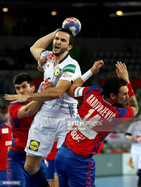 Bogdan Radivojevic of Serbia challenges Romain Lagarde of France during the Men's Handball European Championship main round match between Serbia and...