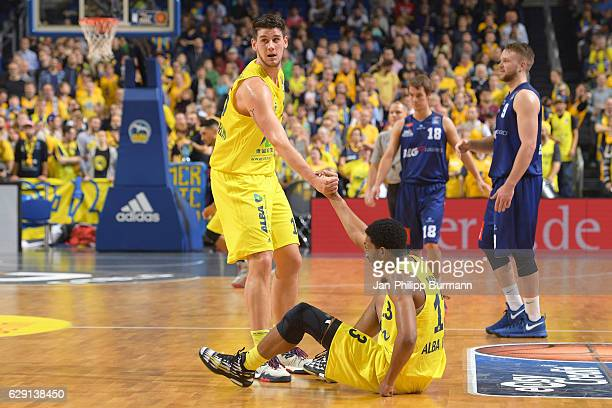 Bogdan Radosavljevic of Alba Berlin and Malcolm Miller of Alba Berlin during the game between Alba Berlin and Eisbaeren Bremerhaven on december 11...
