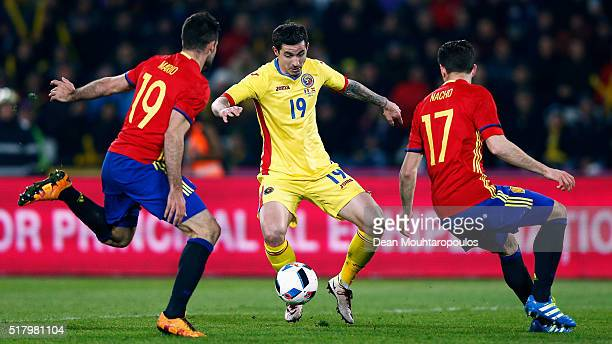 Bogdan Stancu of Romania battles for the ball with Mario Gaspar and Nacho of Spain during the International Friendly match between Romania and Spain...