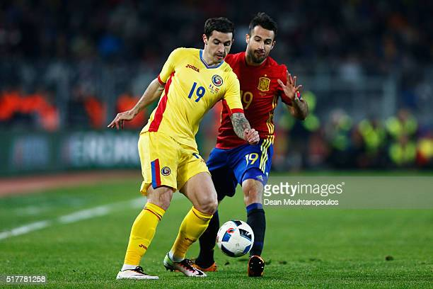 Bogdan Stancu of Romania battles for the ball with Mario Gaspar of Spain during the International Friendly match between Romania and Spain held at...