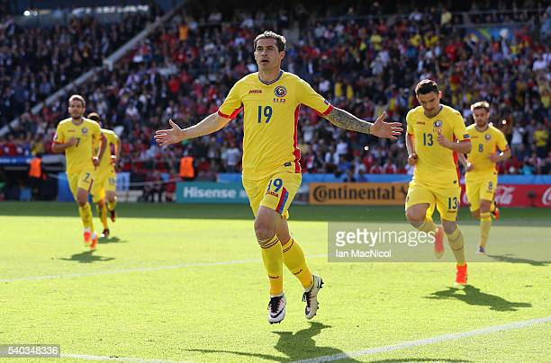Bogdan Stancu of Romania celebrates after he scores the opening goal from the penalty spot during the UEFA EURO 2016 Group A match between Romania...