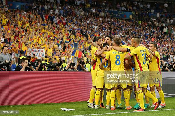 Bogdan Stancu of Romania celebrates scoring a penalty to make the score 1-1 with his team-mates during the UEFA EURO 2016 Group A match between...