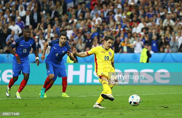 Bogdan Stancu of Romania converts the penalty to score his team's first goal during the UEFA Euro 2016 Group A match between France and Romania at...