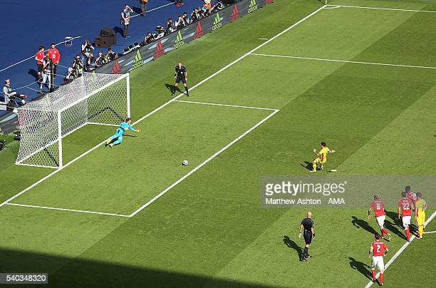Bogdan Stancu of Romania scores from a penalty to make the score 10 during the UEFA EURO 2016 Group A match between Romania and Switzerland at Parc...