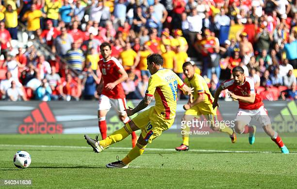 Bogdan Stancu of Romania scores his sides first goal from the penalty spot during the UEFA EURO 2016 Group A match between Romania and Switzerland at...