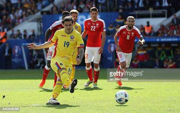 Bogdan Stancu of Romania scores the opening goal from the penalty spot during the UEFA EURO 2016 Group A match between Romania and Switzerland at...
