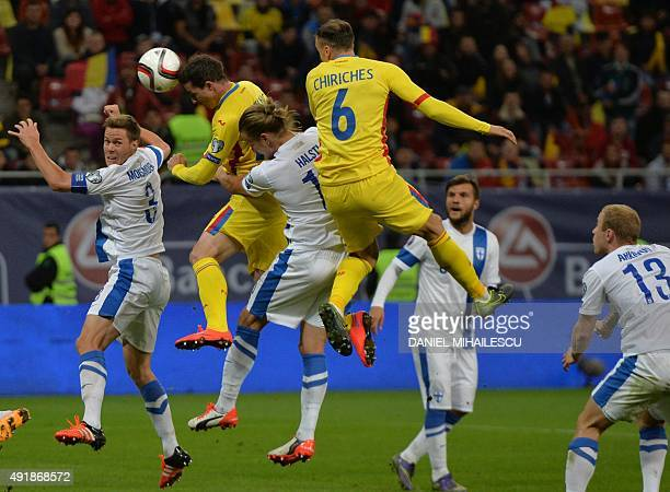 Bogdan Stancu of Romania vies for the ball with Markus Halsti of Finland during the Euro 2016 Group F qualifying football match between Romania and...
