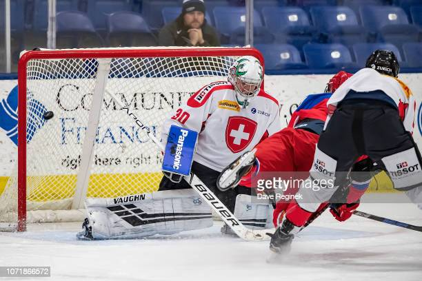 Bogdan Trineev of the U17 Russian Nationals scores a third period goal on Loïc Galley of the Switzerland Nationals during the 2018 Under17 Four...