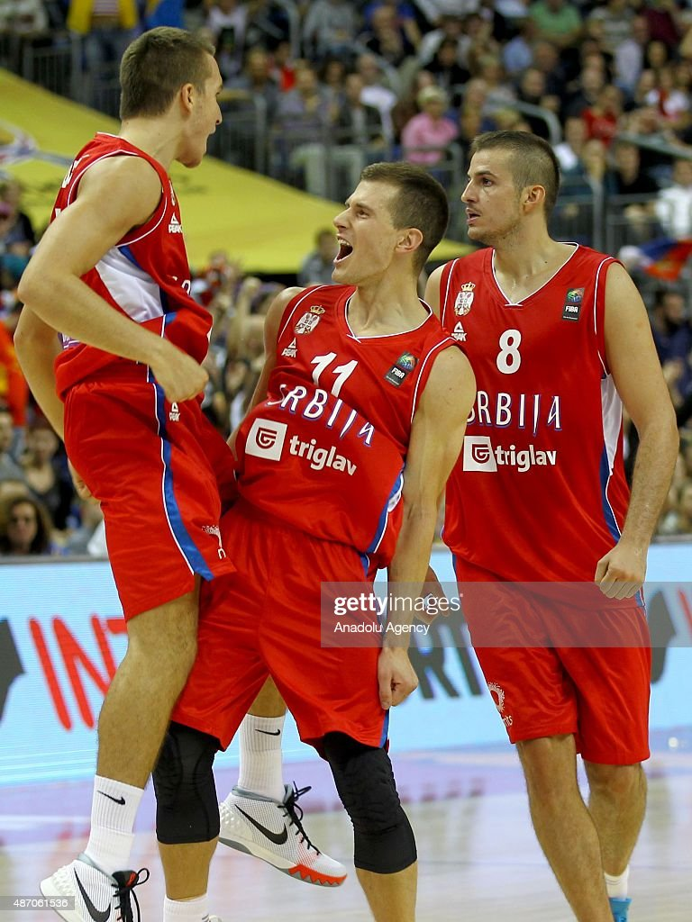 Bogdanovic (L) and Nedovic (11) of Serbia gesture during the EuroBasket 2015 group B match between Spain and Serbia at Mercedes-Benz Arena in Berlin, Germany on September 5, 2015.