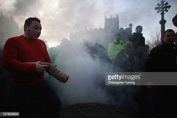 Boggin prepares a hood as the Haxey Hood game at Haxey Village begins at dusk on January 6 2011 in Doncaster England The origins of the ancient game...