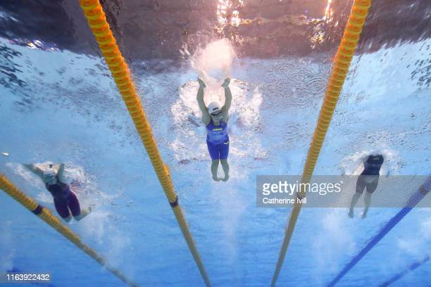 Boglarka Kapas of Hungary Svetlana Chimrova of Russia and Laura Stephens of Great Britain compete in the Women's 200m Butterfly Semifinal on day four...