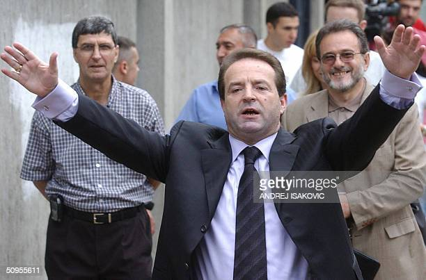 Bogoljub Karic an independent presidental candidate waves to the media in front of a polling station in Belgrade 13 June 2004 The election scheduled...