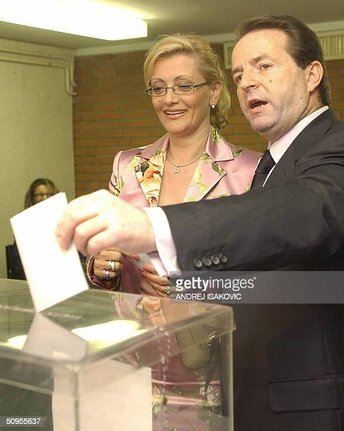 Bogoljub Karic independent presidental candidate and his wife Milanka cast their votes at a polling station in Belgrade 13 June 2004 The election...
