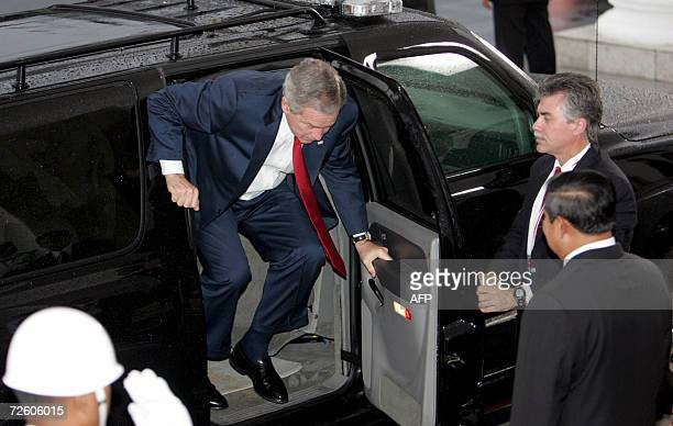 US President George W Bush disembarks from a car as his Indonesian Counterpart Susilo Bambang Yudhoyono looks on at the Presidential Palace in Bogor...