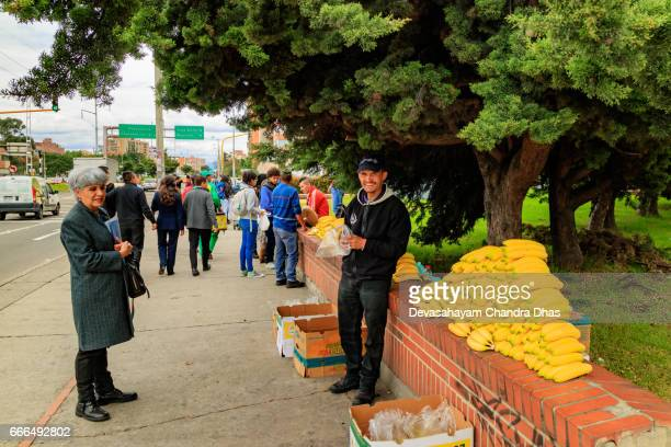 Bogotá, Colombia - A Man Sells Bananas to Passers-by on the Sidewalk in the El Bosque Area