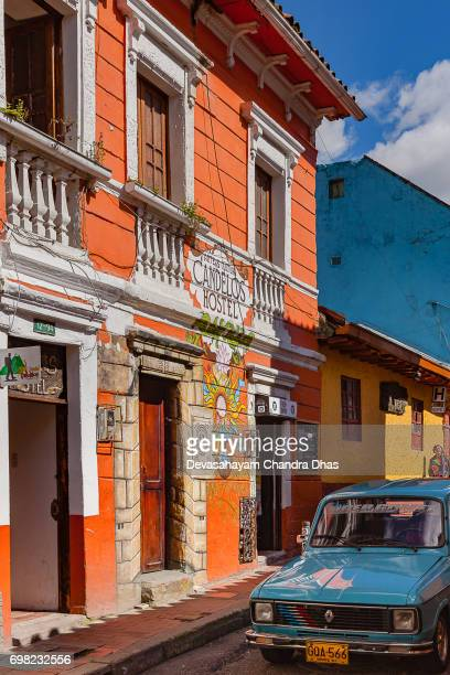 Bogotá, Colombia - An Old Renault 4 Drives Through a Narrow Street in the Historic La Candelaria District of the Andean Capital City