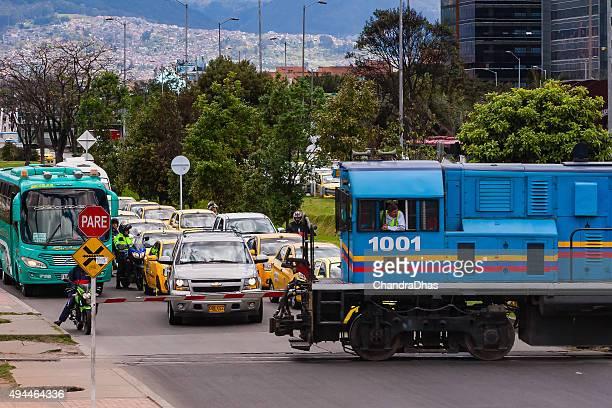 bogotá, colombia -  diesel railway engine crosses avenida el dorado. - cowcatcher stock pictures, royalty-free photos & images
