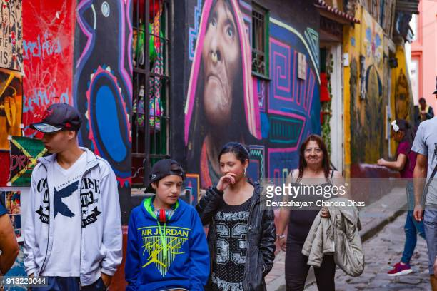 Bogotá, Colombia - Local Colombians On The Cobblestoned Calle del Embudo, In The Historic La Candelaria District of The Andean Capital City