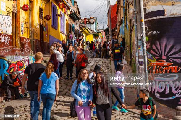 Bogotá, Colombia - Looking Up The Cobblestoned Calle del Embudo From The Broader End, In The Historic La Candelaria District of The Andean Capital City