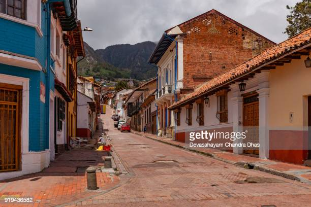 Bogotá, Colombia - Looking Uphill On One Of The Colorful Streets In The Historic La Candelaria District Of The Andean The Capital City