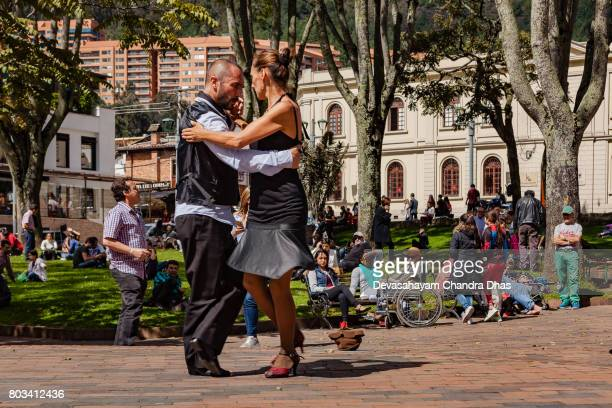 Bogotá, Colombia - The Mercado de Las Pulgas in the Popular Usaquén District. A Couple of Street Dancers Dance the Tango to Entertain Visitors.